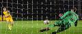 Swansea goalkeeper Steven Benda saves a penalty