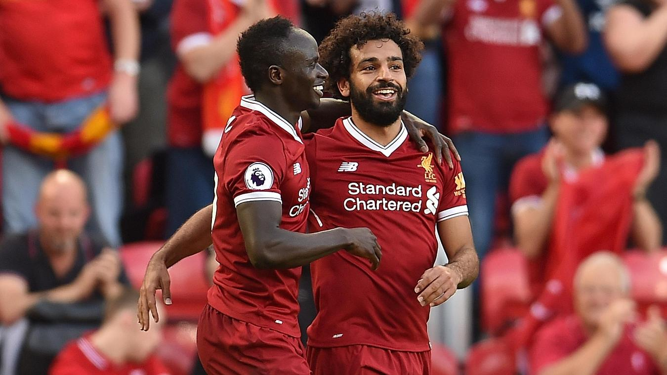 Sadio Mane and Mohamed Salah celebrate after scoring Liverpool's second and third goals