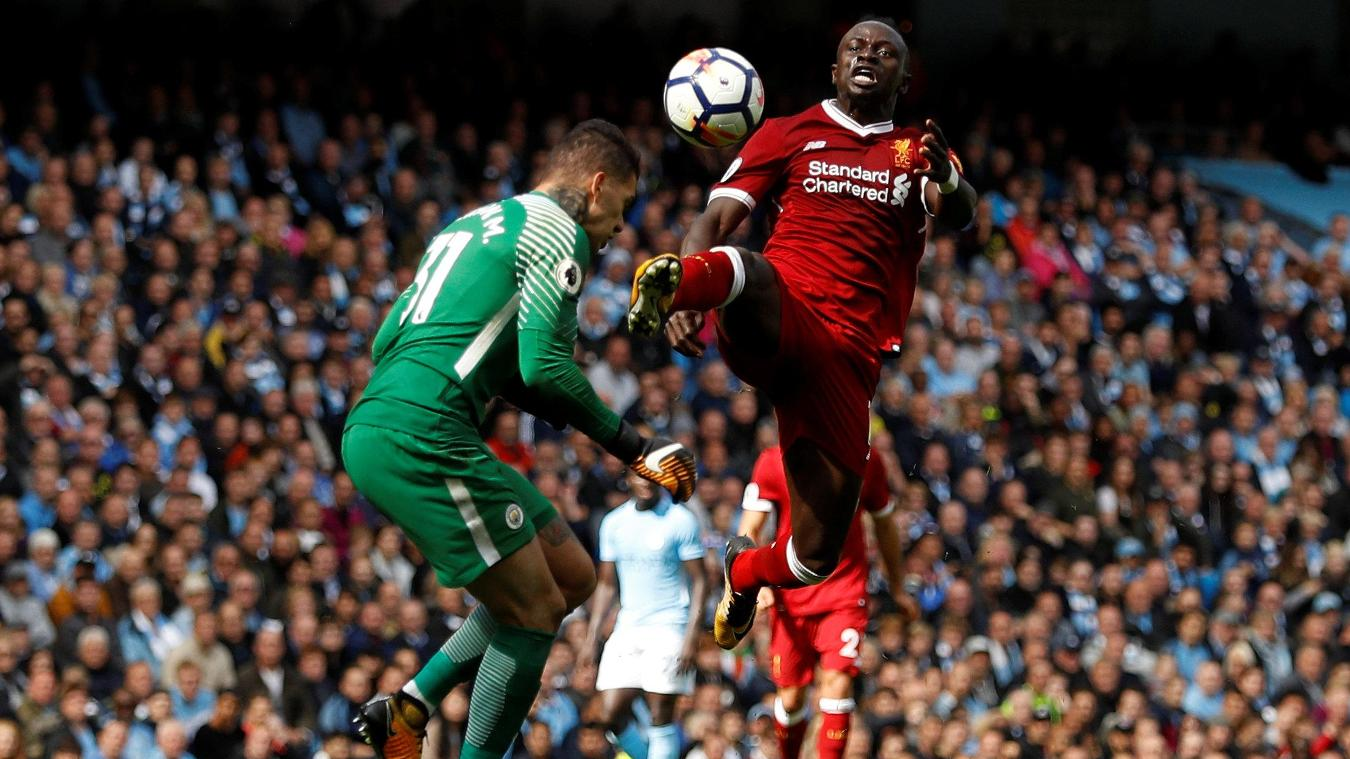 Sadio Mane raises his foot as he challenges Ederson, earning a red card