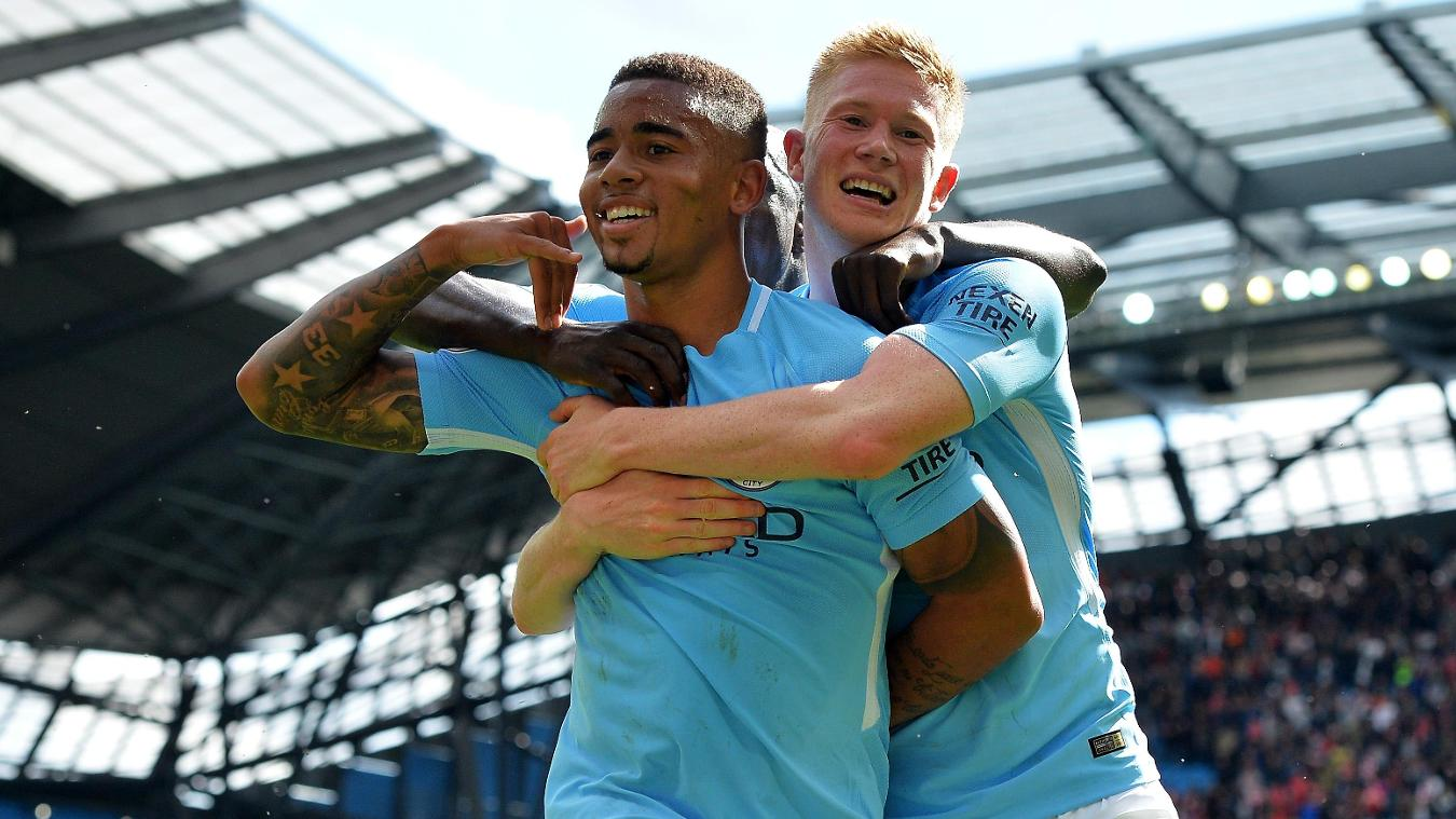 Kevin De Bruyne, right, celebrates with Gabriel Jesus after setting up the first of the Brazilian's goals