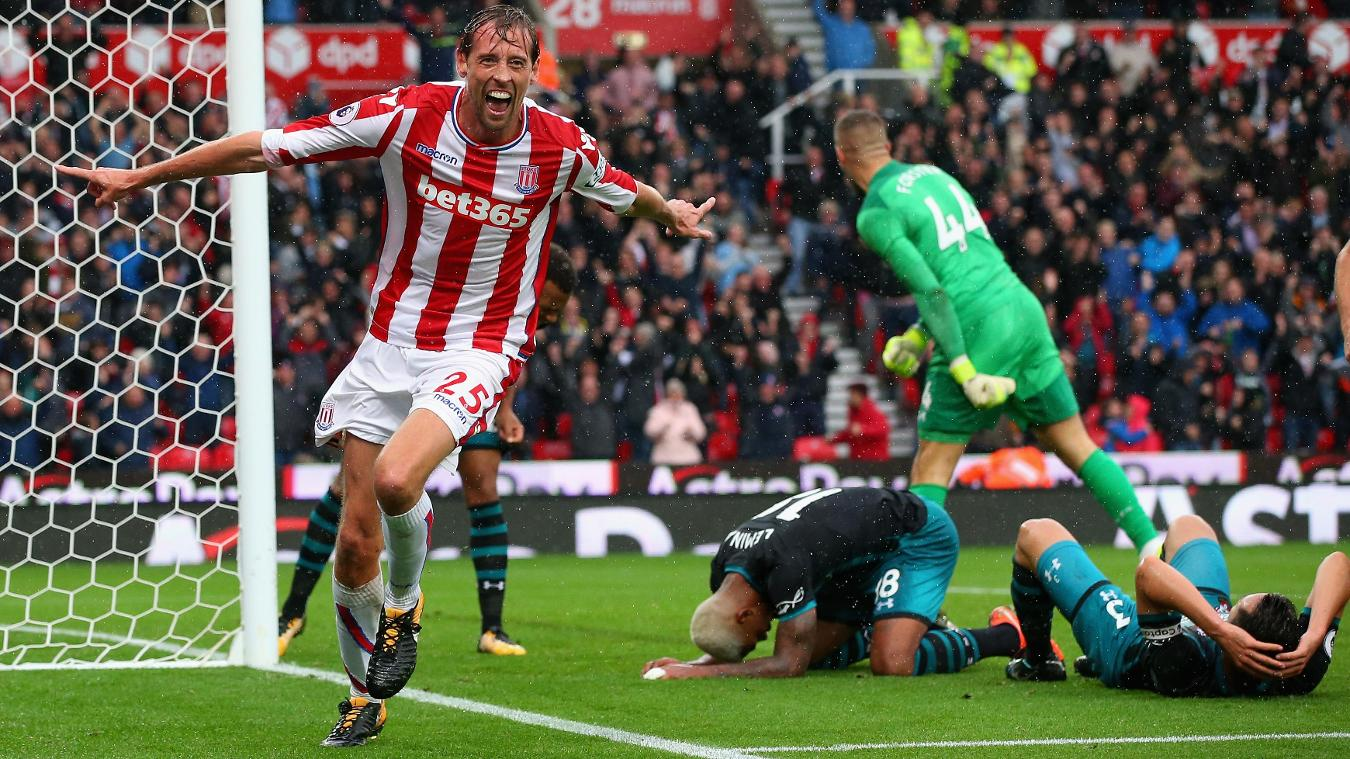 Peter Crouch celebrates his 85th-minute strike