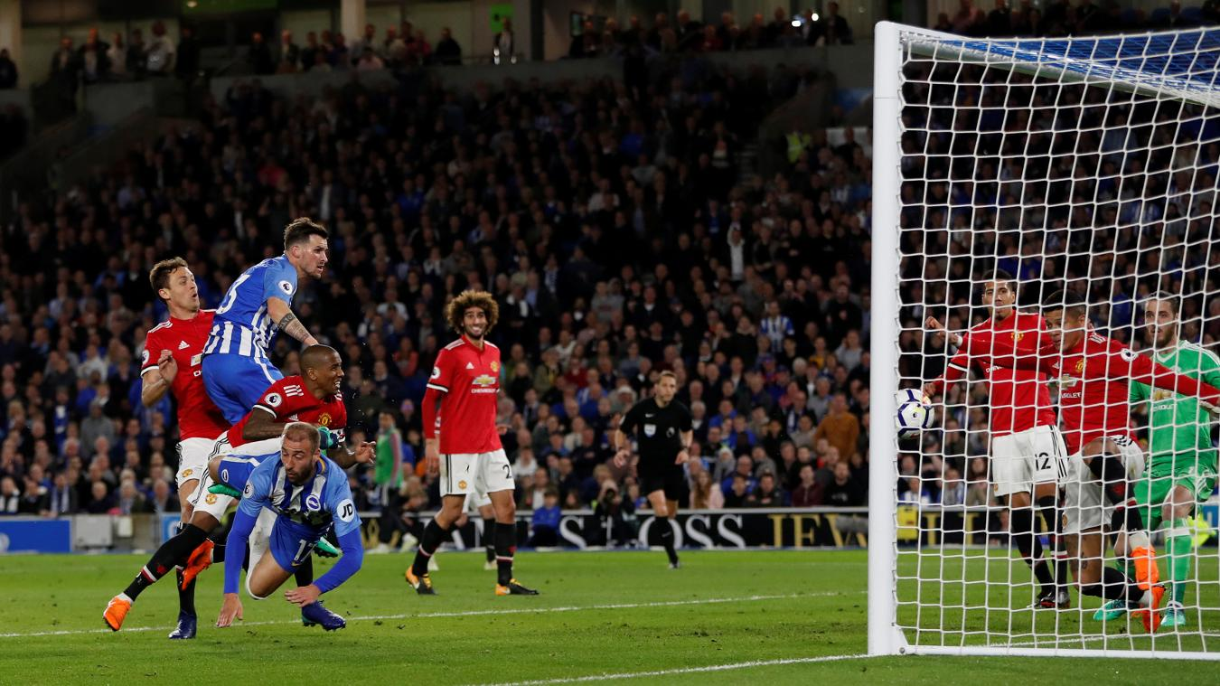 Pascal Gross watches as his header crosses the line