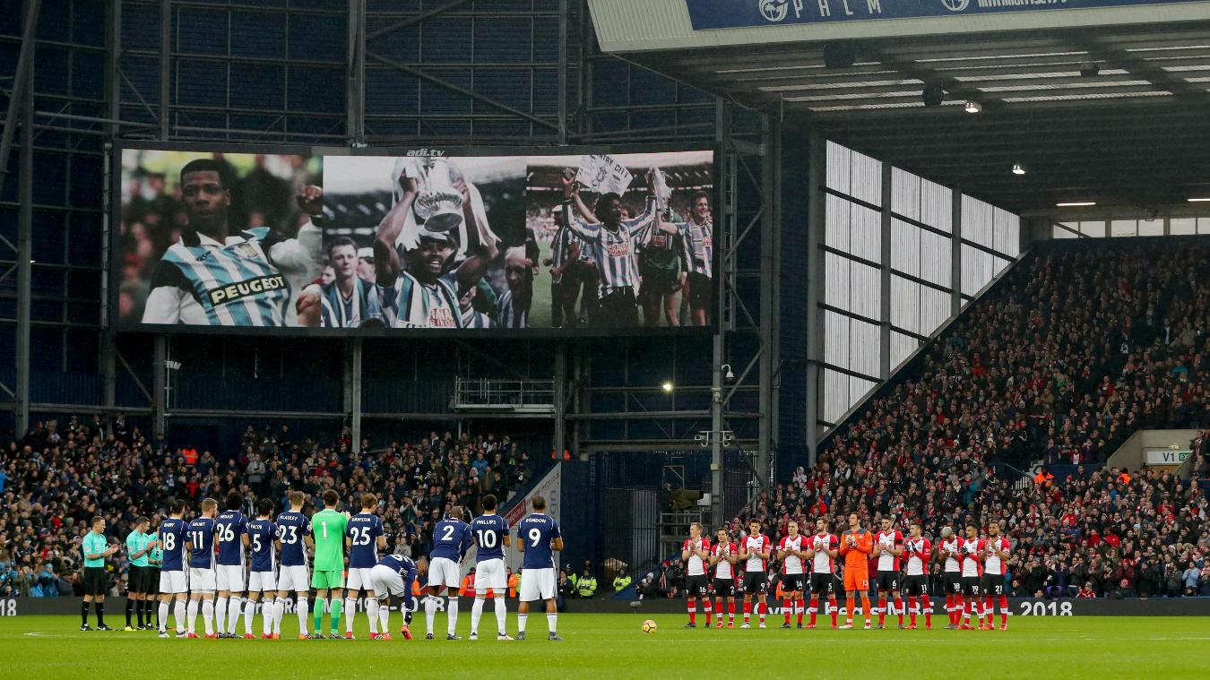 The two teams lead a minute's applause for Cyrille Regis before kick-off