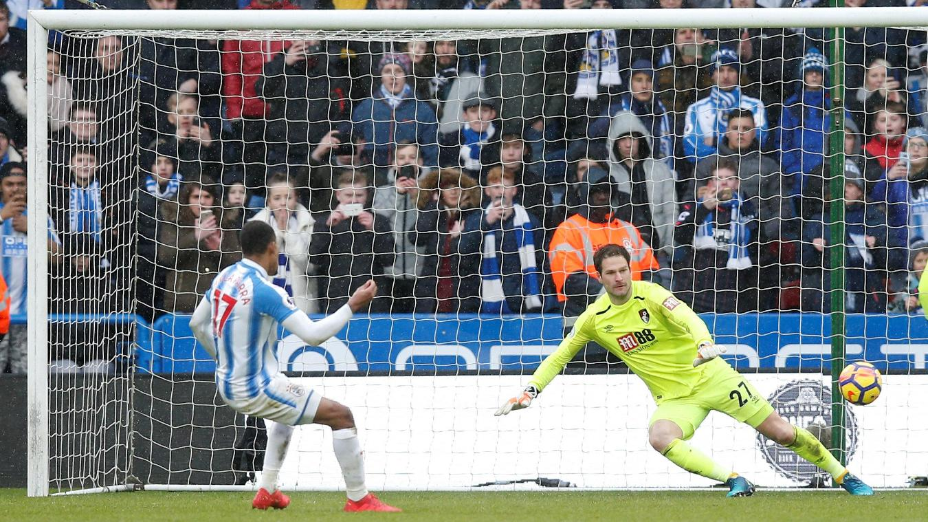 Rajiv van La Parra slots home from the penalty spot to wrap up Huddersfield Town's victory