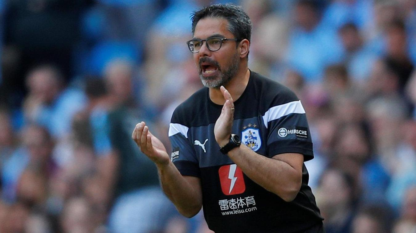 Huddersfield Town manager David Wagner urges his players on as they close in on an invaluable point