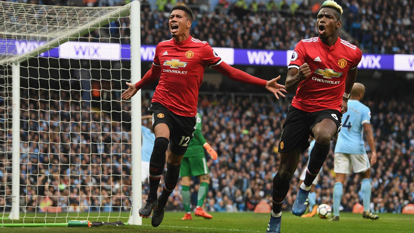 Manchester United's goalscorers Chris Smalling, left, and Paul Pogba celebrate the winner
