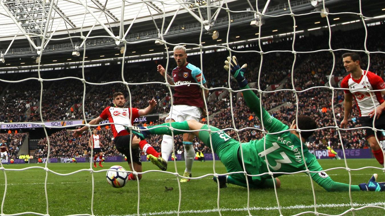 Marko Arnautovic tucks the ball past Alex McCarthy to put West Ham United 2-0 ahead