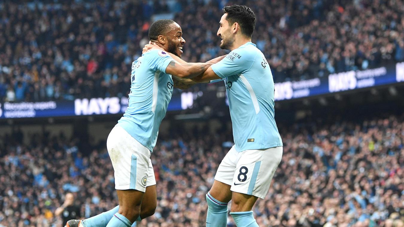 Ilkay Gundogan, right, embraces Raheem Sterling after giving Manchester City a 2-0 lead