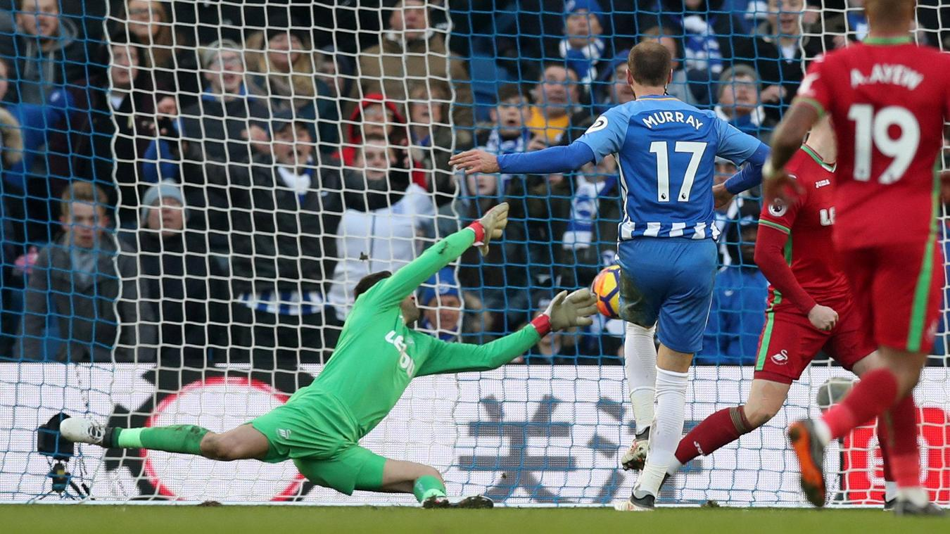 Glenn Murray forces the ball into the net to score his and Brighton's second goal