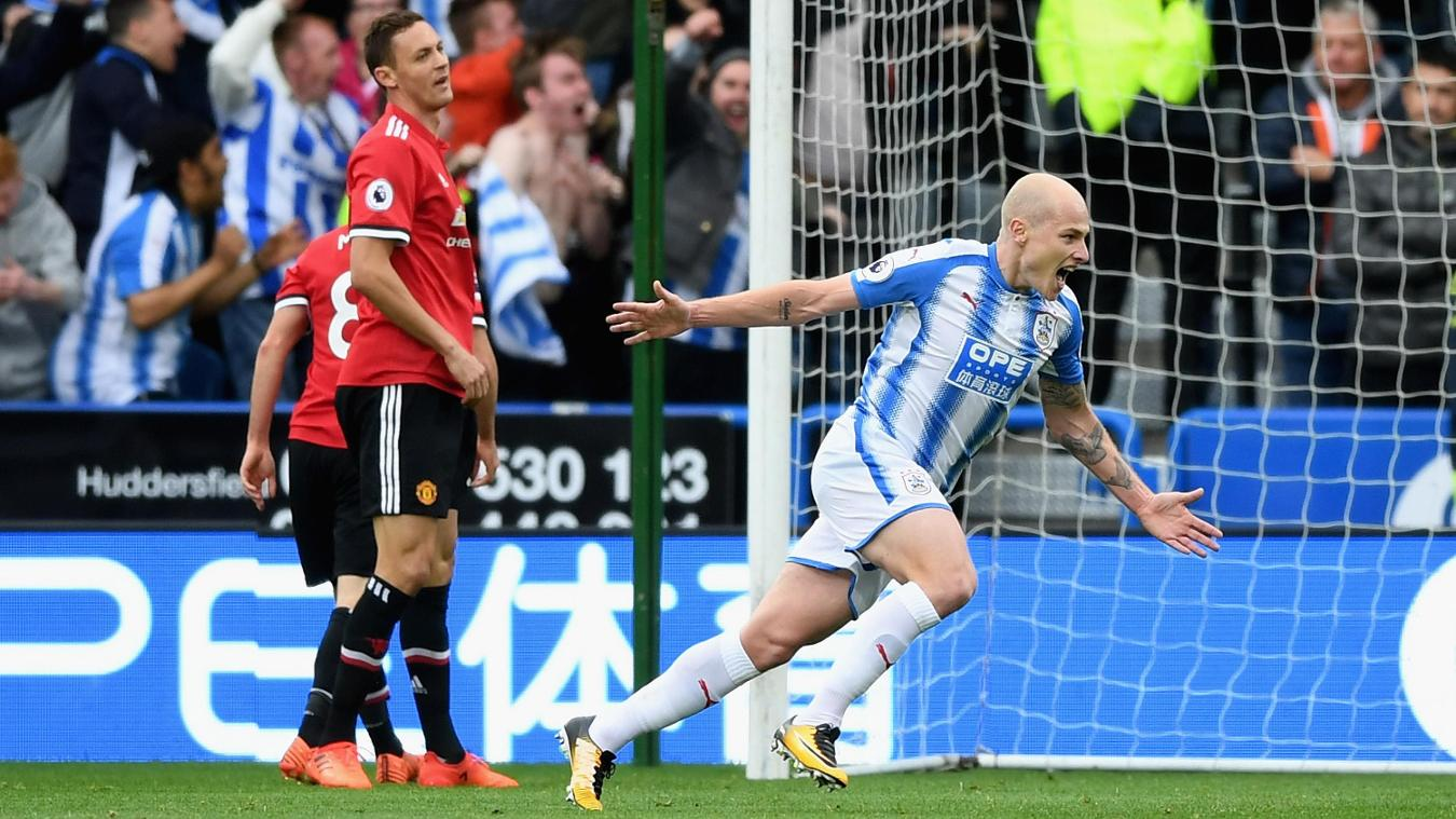 Aaron Mooy celebrates after opening the scoring