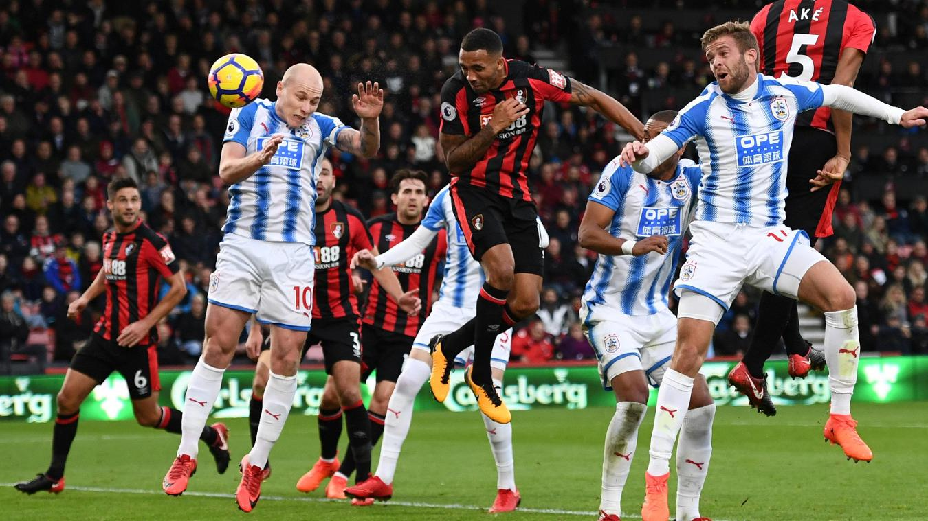 Callum Wilson, centre, heads in the first of his three goals