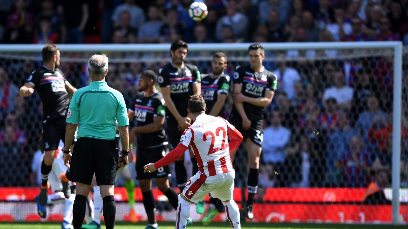 Xherdan Shaqiri curls his free kick towards the top right corner, giving Stoke City the lead