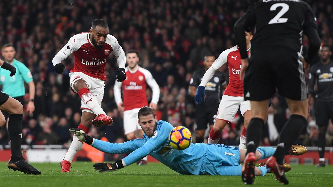 David De Gea dives to deny Alexandre Lacazette - one of his 14 saves during the match