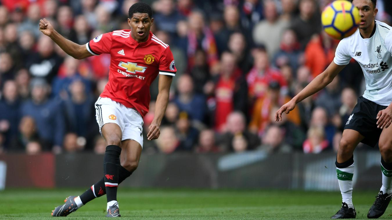 Marcus Rashford whips the ball into the net to open the scoring