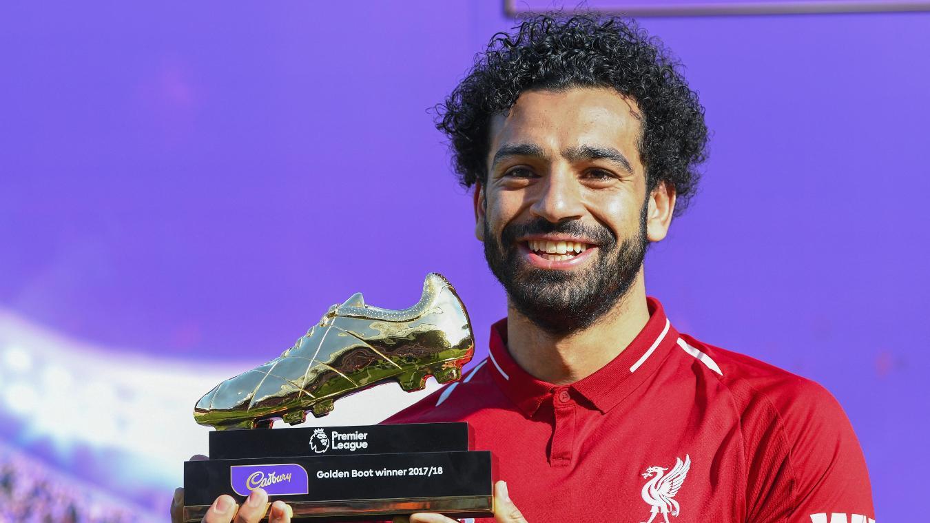 Mohamed Salah shows off his Golden Boot trophy