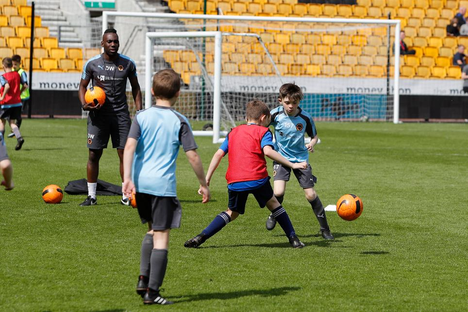 BAME coach runs a training session for Wolves