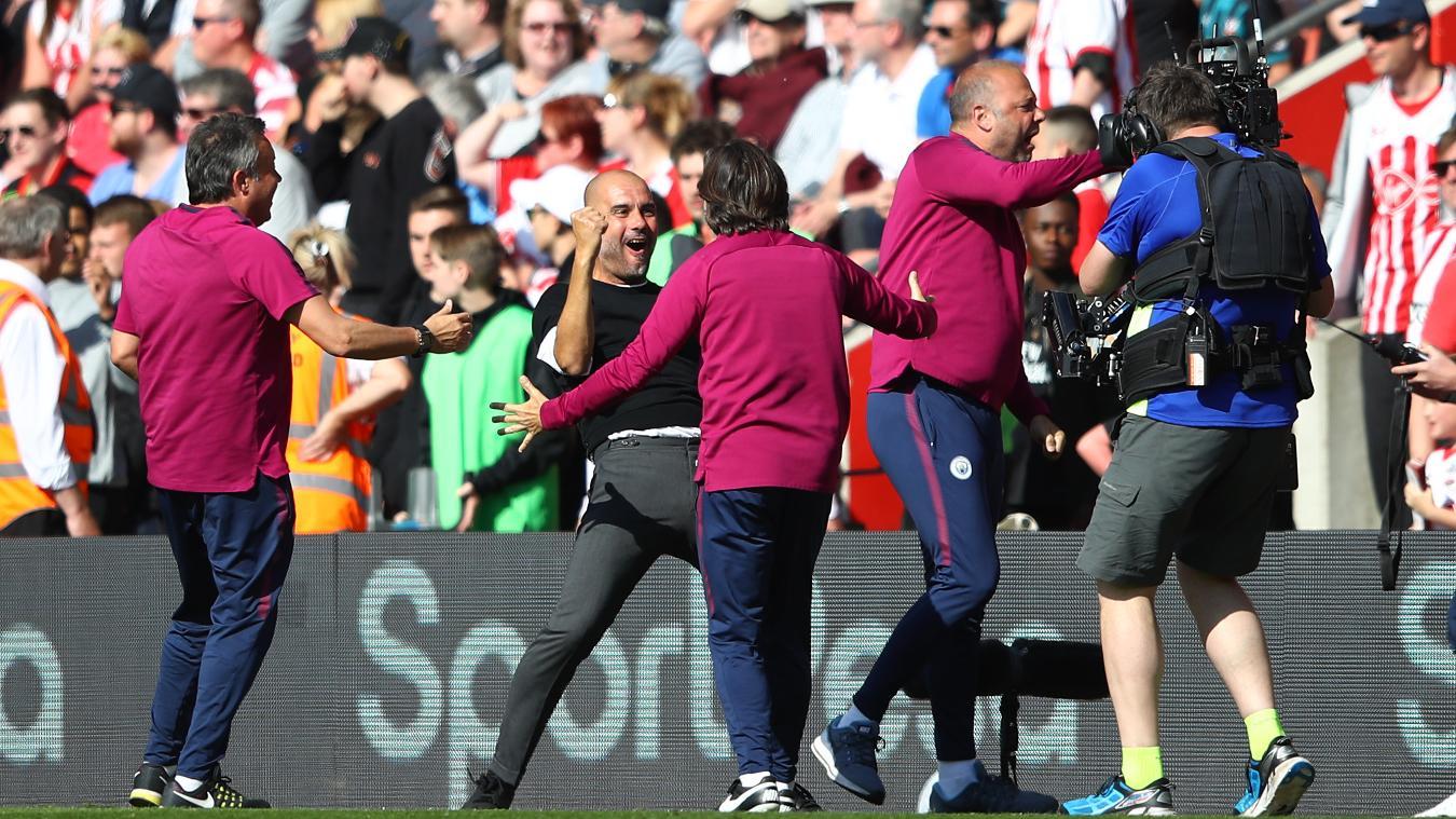 A jubilant Guardiola celebrates with his staff