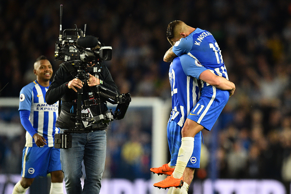Brighton's players celebrate in front of the camera