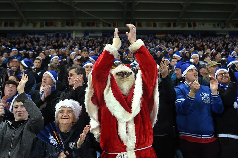 A fan in fancy dress watches Leicester City v Man Utd