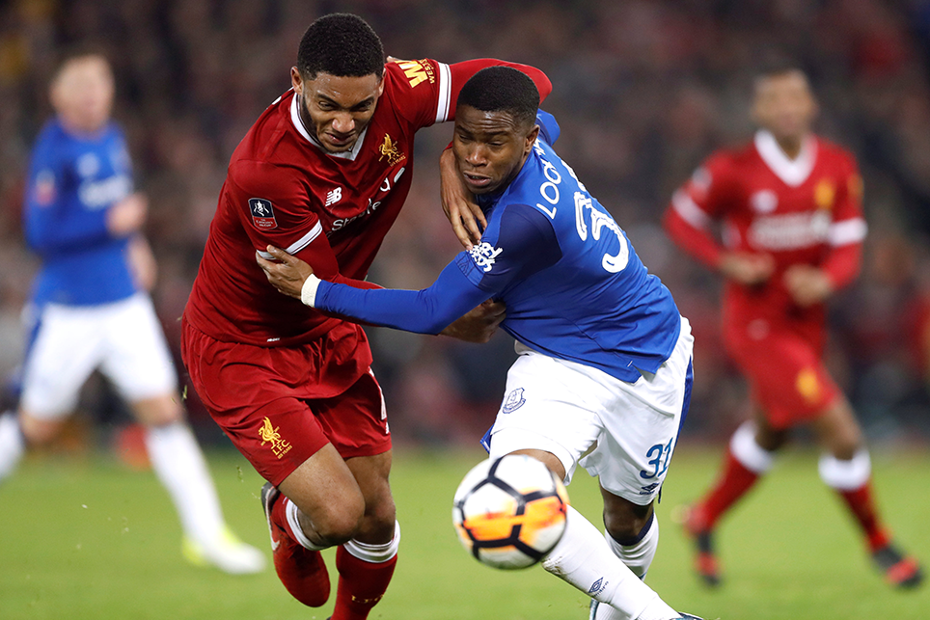 Joe Gomez and Ademola Lookman compete for the ball in the Merseyside derby