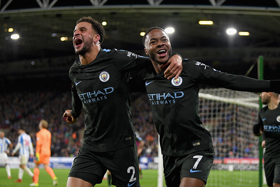 Kyle Walker and Raheem Sterling celebrate a goal for Man City