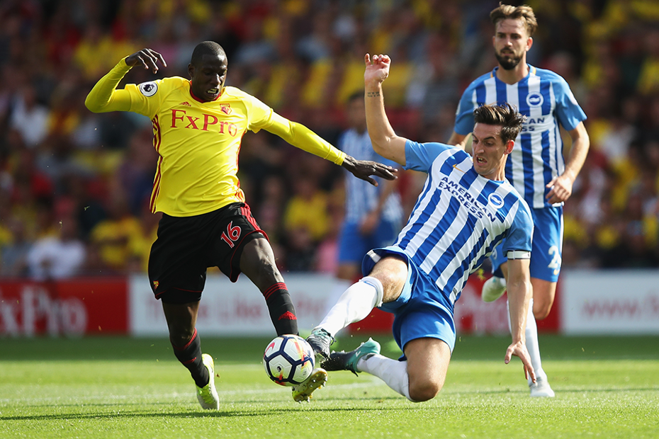 Watford's Abdoulaye Doucoure and Brighton's Lewis Dunk