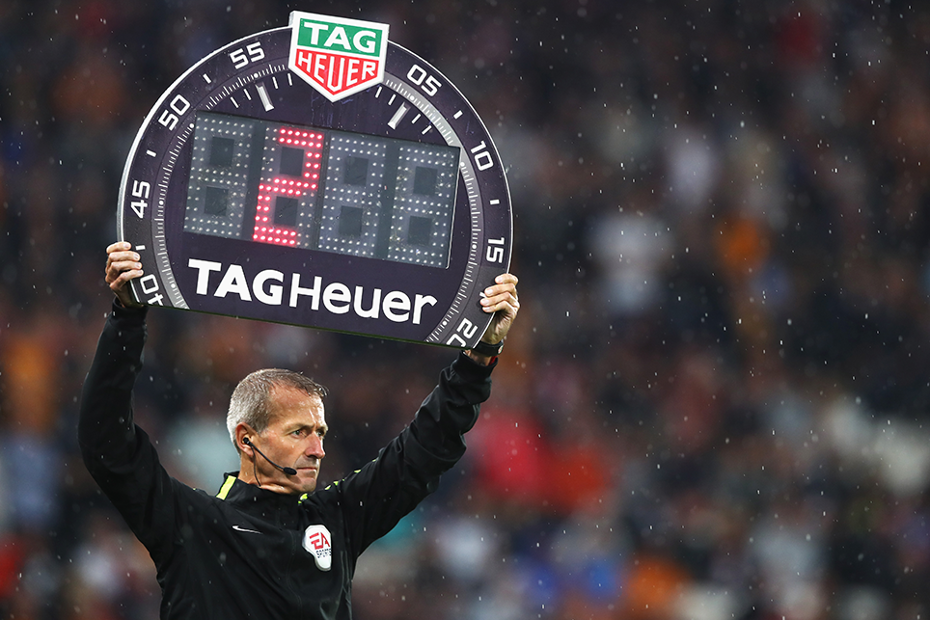 Match official holds TAG Heuer board
