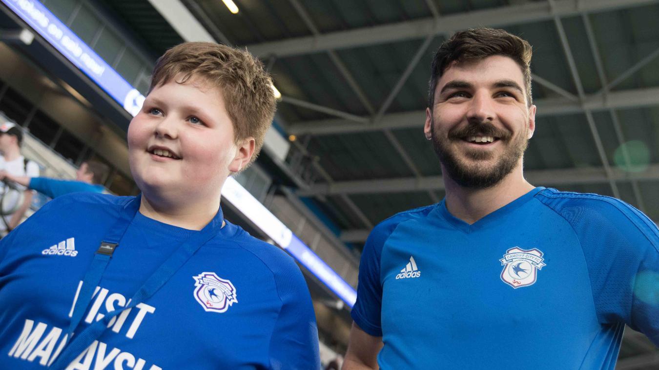 Callum Gyde and Cardiff City's Callum Paterson