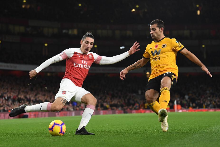 Arsenal's Hector Bellerin in action against Wolves' Jonny Otto