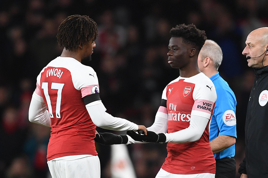 Arsenal's Bukayo Saka comes on for Alex Iwobi